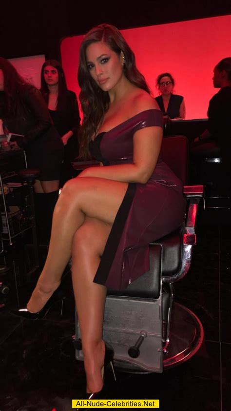 Ashley Graham shows legs and sexy cleavage