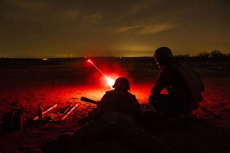 File:Red tracers light up the night as members of the